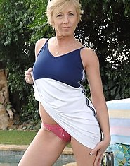 Anilos cougar Chanel teases as she exposes her pink underwear outdoors